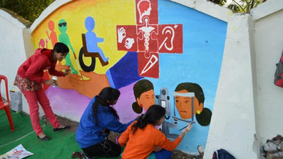 Art students from Sarjana Academy work on mural promoting equitable access to health care for people with disabilities
