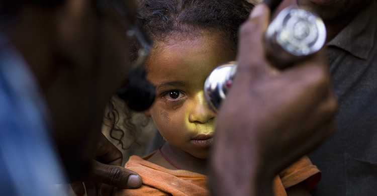 A child having their eyes tested
