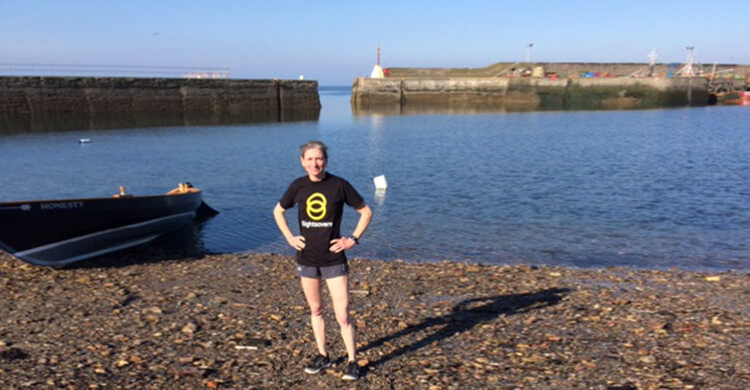 Chris takes a break during her final long training session, she ran 16 miles from Edinburgh to Aberlady.