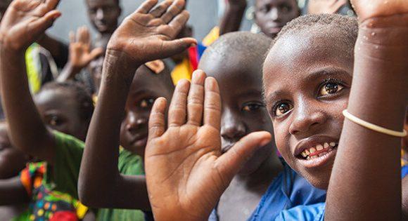 Children waving.