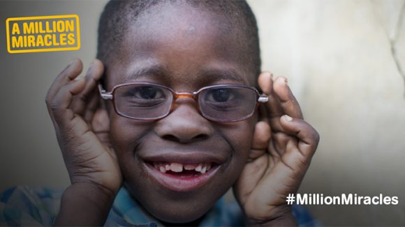 A boy wearing glasses