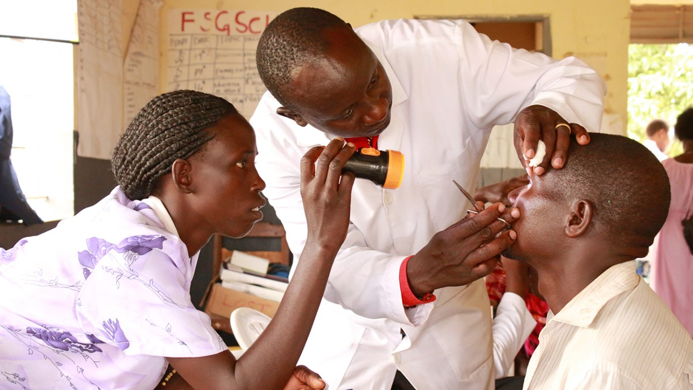 A woman has her eyes examined as part of a CATCH screening programme in Uganda.