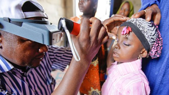 A girl's eyes are examined as part of the Global Trachoma Mapping Project in Nigeria.