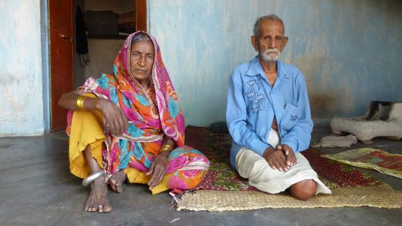 Amarchand and his wife Phullobai pose for a photo inside their house in the Piriya slum of Bhopal, India.