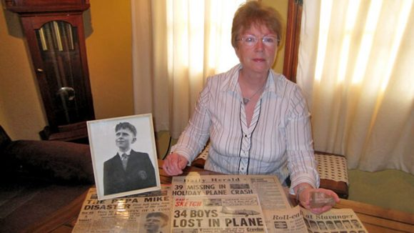 Rosalind Jones with a photo of Quentin Green