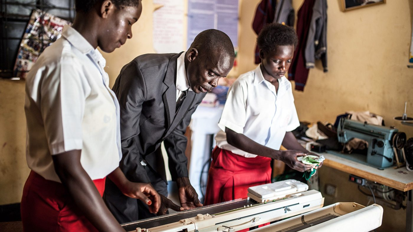 Simon Peter Otoyo teaching knitting to his students at Amor Foundation Vocational Training School in Bweyale, Uganda.
