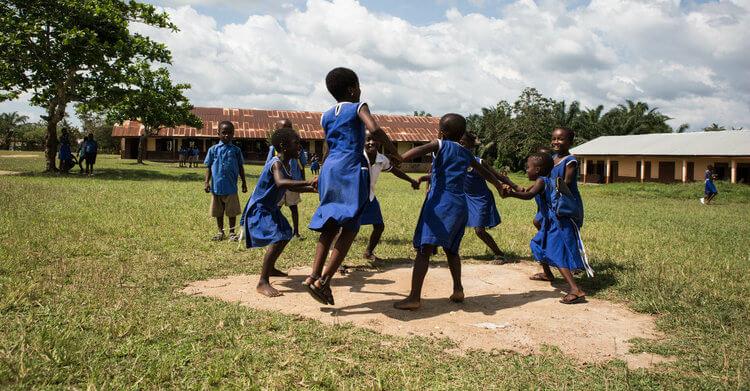 School children dancing together