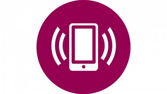 A circular icon showing a white mobile phone with sound waves emanating from it, on a purple background.