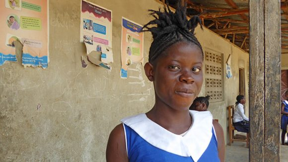 A girl standing outside a school