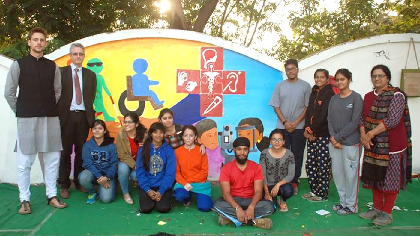 Students and Sightsavers staff in front of one of the finished murals.