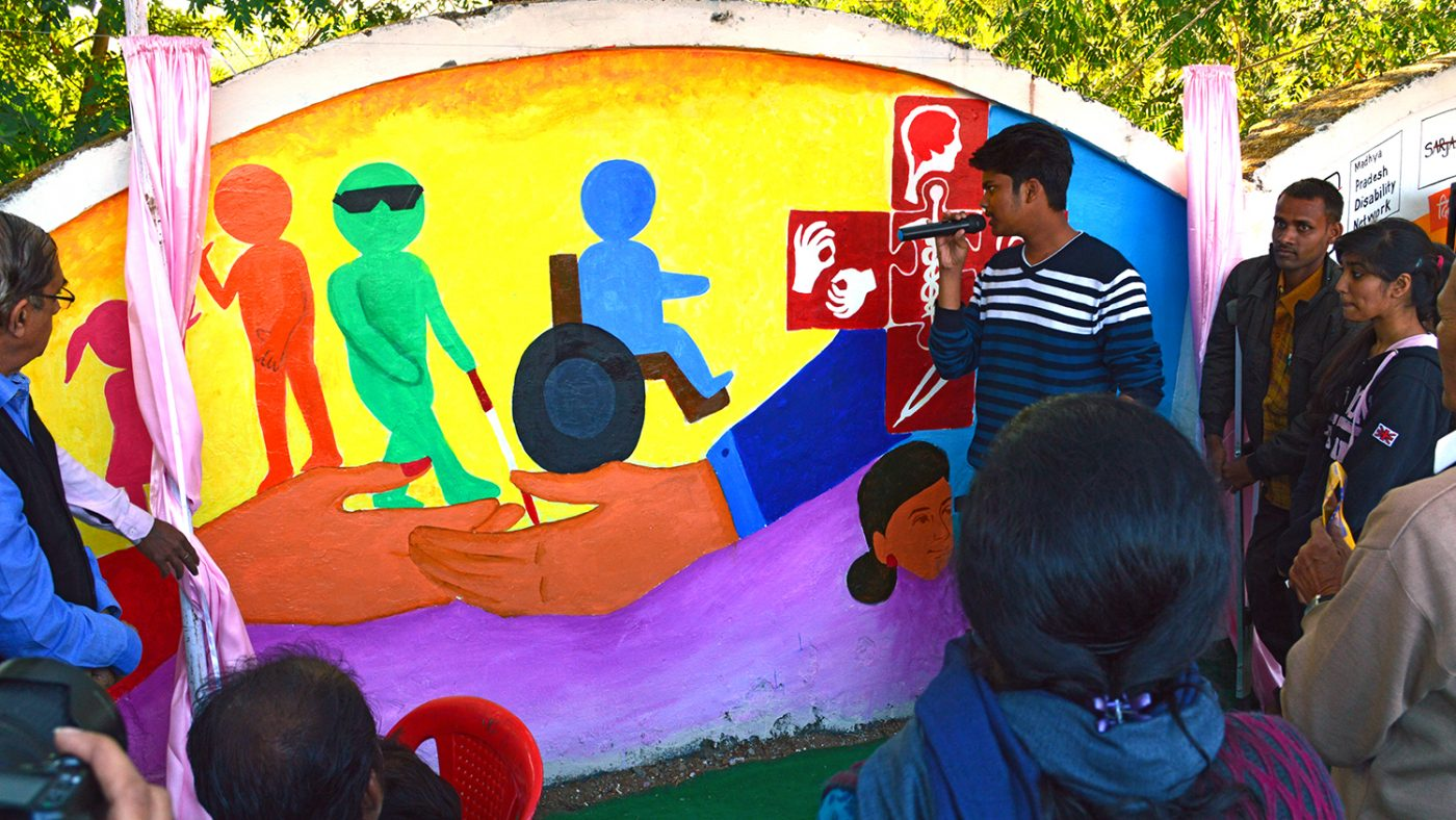 Art students painting the Inclusive Eye Health mural in Bhopal.