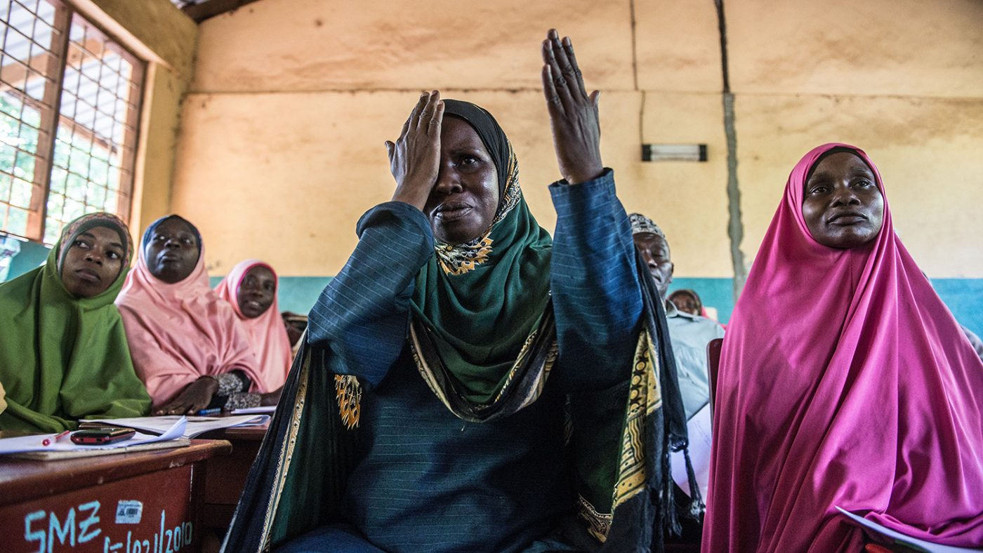 Teacher Mtumwa Salini Hamadi covers one eye to simulate an eye test as part of the training session.