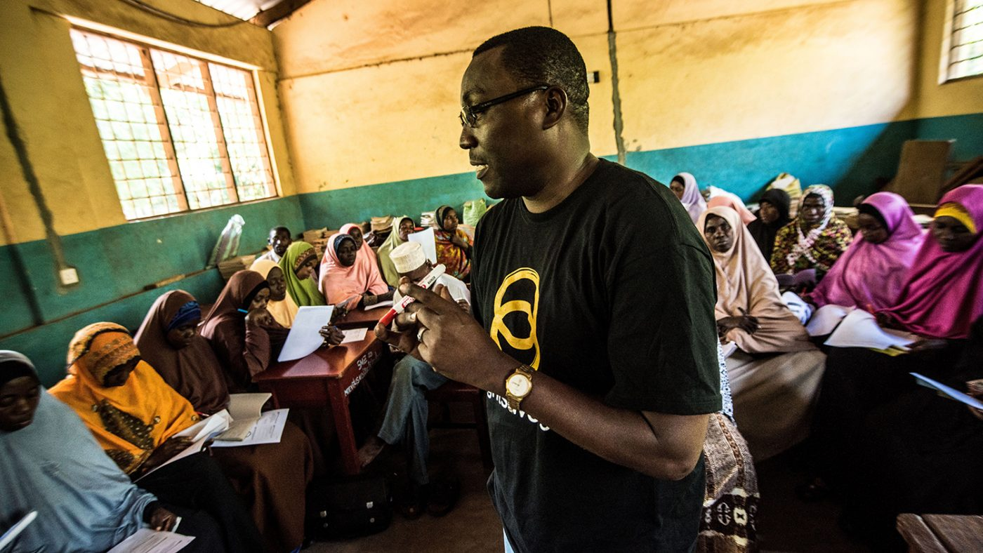 Dr Rajab stands in front of the classroom as he teaches a group of teachers about visual impairment.