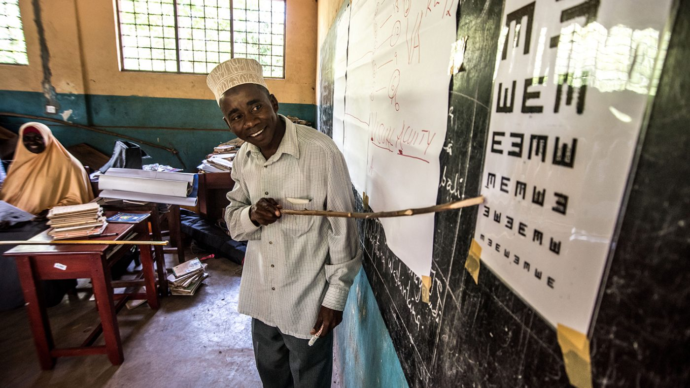 Mohamed Makame Sheha, a teacher from the Jongowe primary school, practises pointing at a sight chart as part of his training in visual impairments.