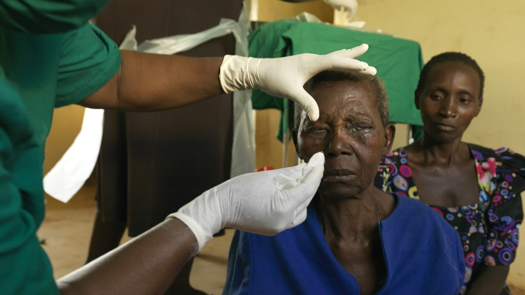 Trichiasis patient Edisa Nalubanga has her bandages removed after surgery.