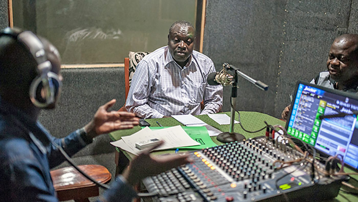 DJ Robert Musasizi, district health officer Patrick Baguma and district onchocerciasis co-ordinator William Mugayo take part in the on-air discussion.