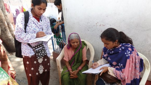 Data collectors take information in Bhopal, India.