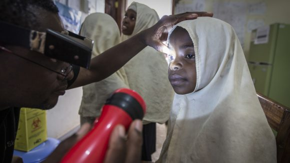 A girl having her eyes checked