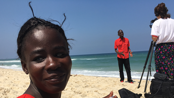 Paralympian Taonere Banda on a beach