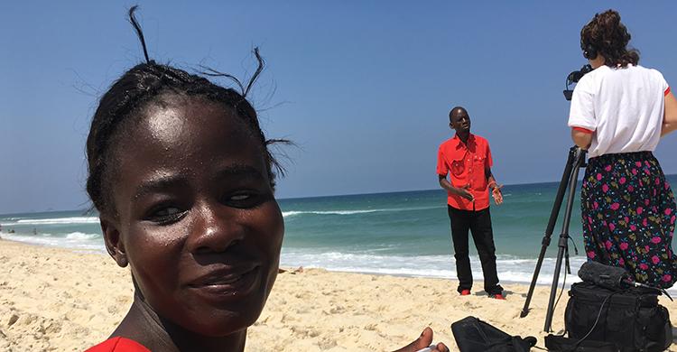 Paralympian Taonere Banda on a beach