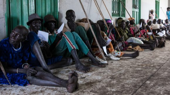 Patients wait in line to take their visual acuity tests during the cataract and trachoma outreach program in Nasir, Upper Nile, South Sudan, September 2, 2013.