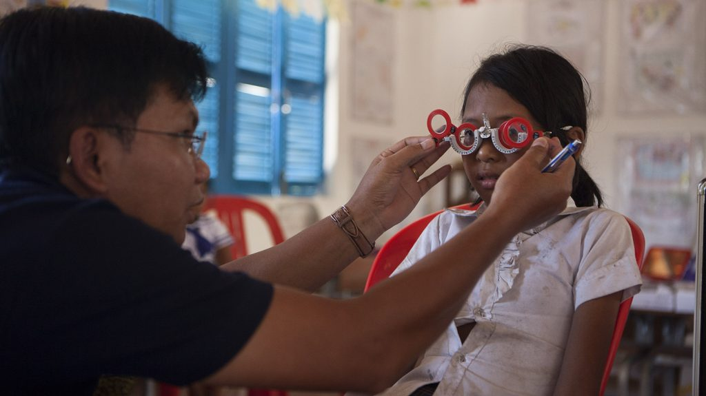 A child has her eyes tested at a school in Cambodia as part of the SHIP project.