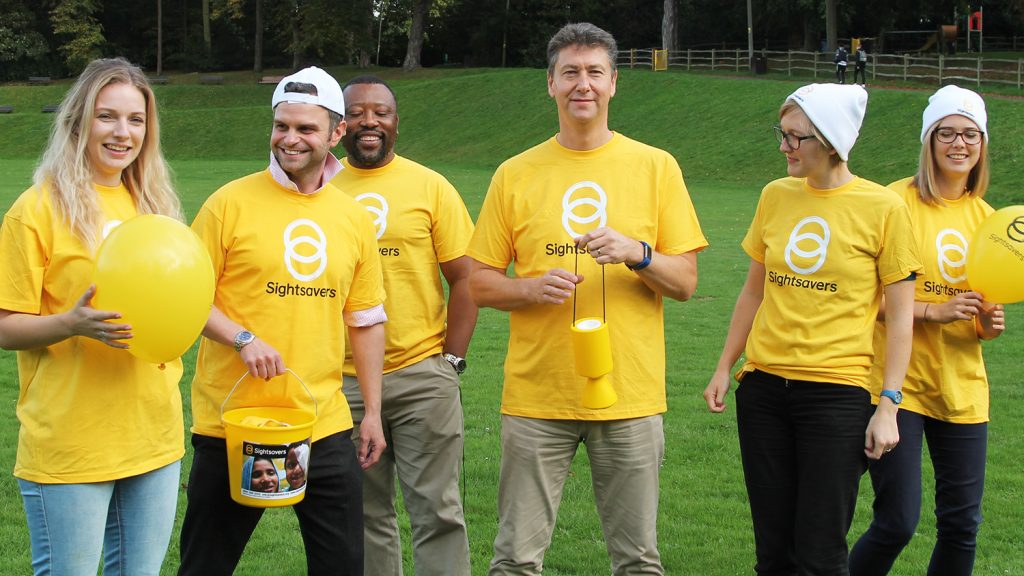 Group of people wearing Sightsavers t-shirts