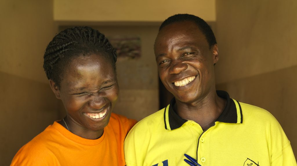 Harriet and her father Hosea laughing together.