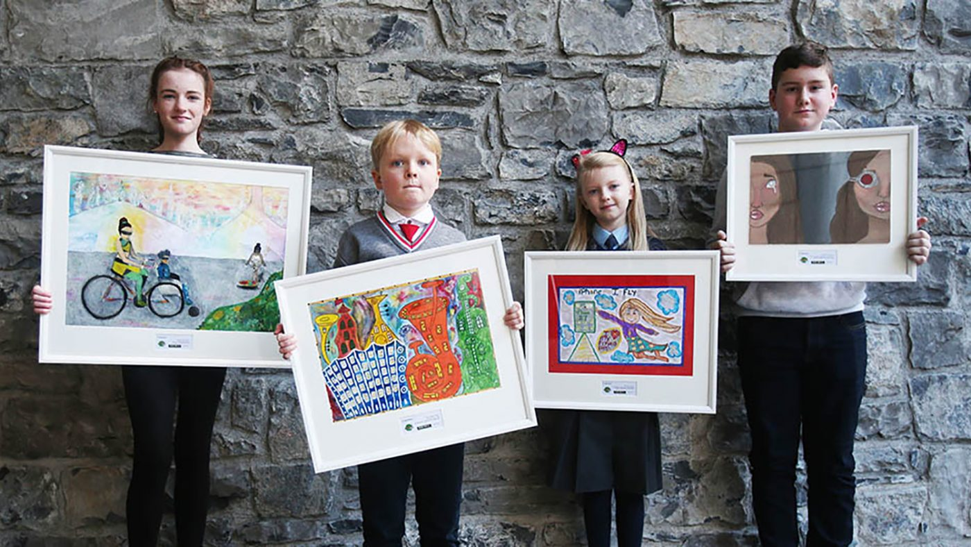 The four winners from the 2017 competition: Sarah Mullaney, Dylan Williams, Ella Taylor and Shane Maher pose with their paintings.
