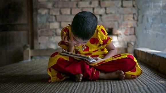 Muslima struggles to read a book.