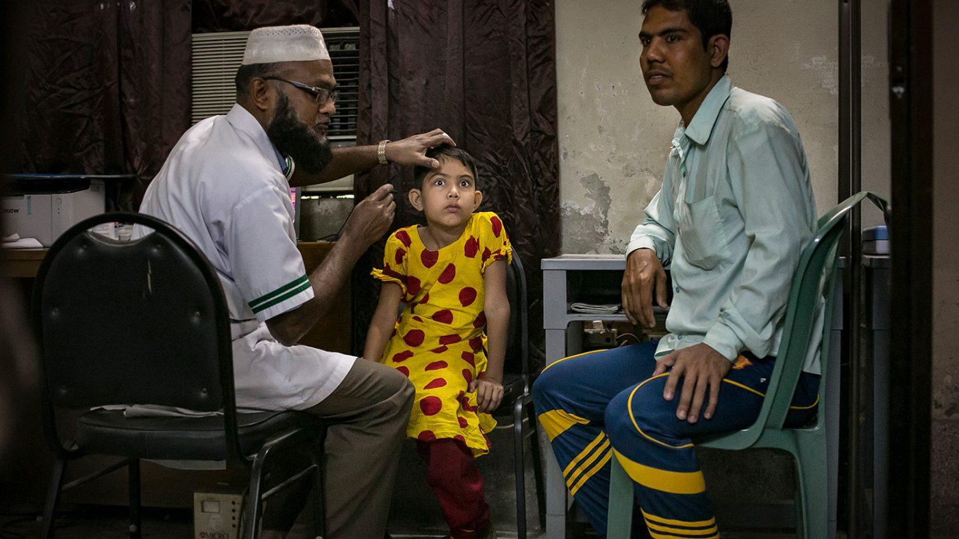 Muslima has her eyes screened.