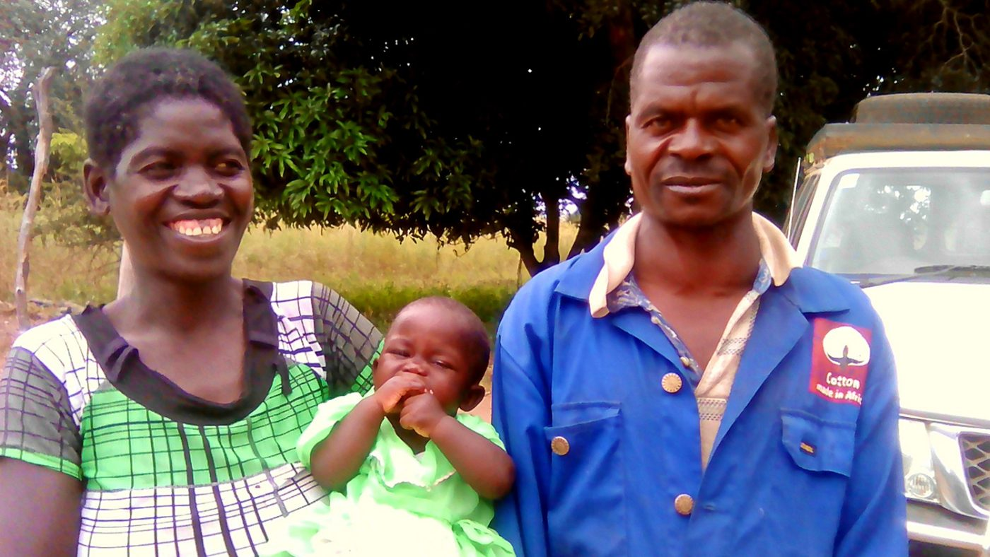 Zonobia's mother and father pose for the camera with their youngest daughter.