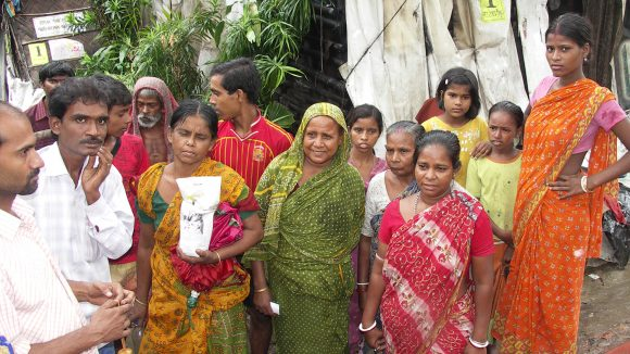 A group of residents in Kolkata, dressed in colourful clothing.