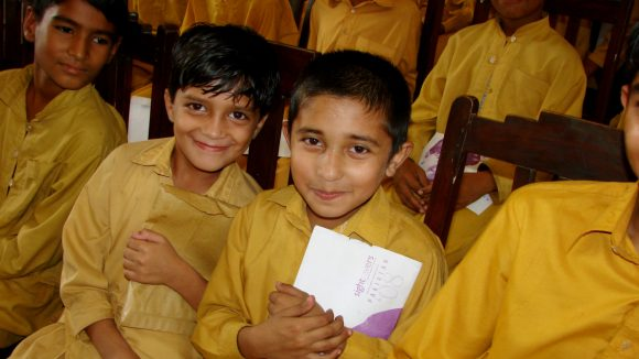 Children attend a seminar for World Sight Day in Pakistan.