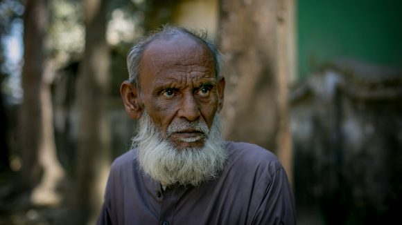 A man stands alone in Bangladesh.