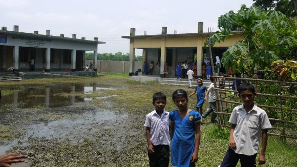 Children stand outside their school in Bangladesh.