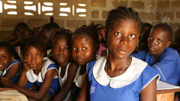 A visually impaired girl studies with her classmates in Sierra Leone.