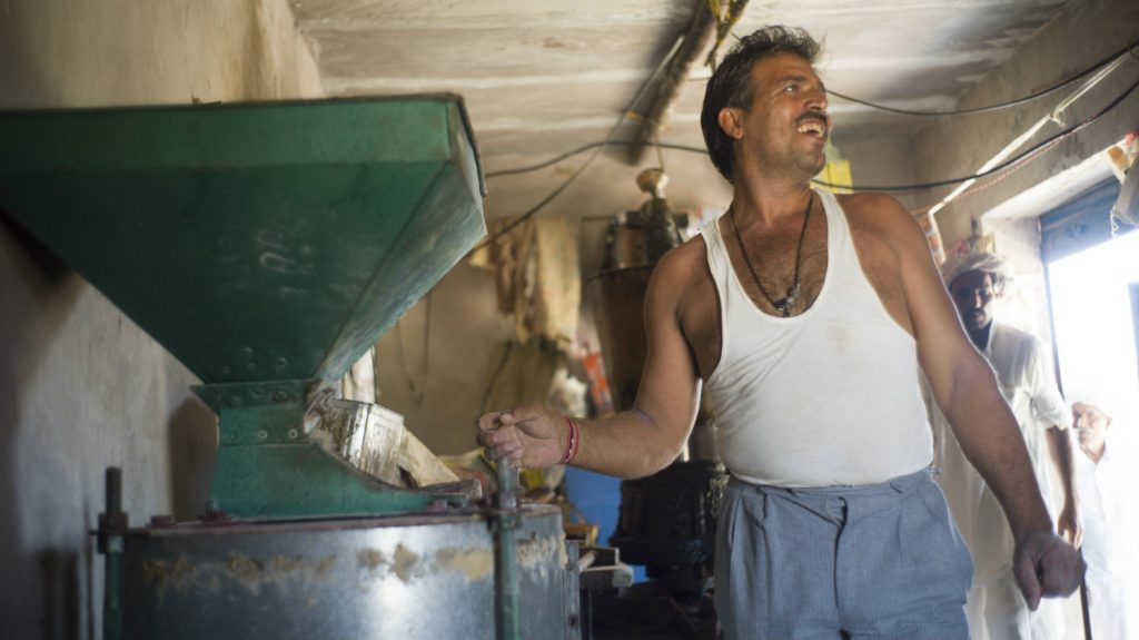 Bhagirath smiles as he works.