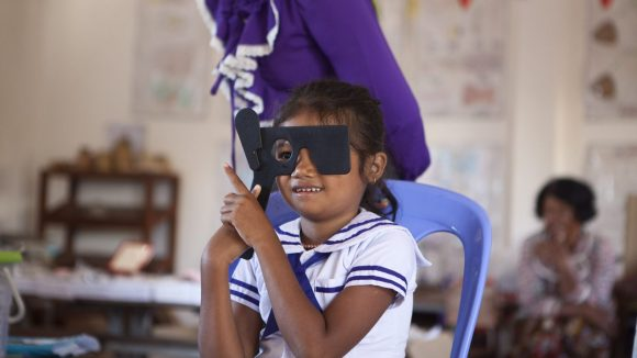 A child undertakes an eye test in Cambodia.
