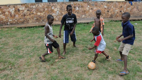 In Ghana, children play football.