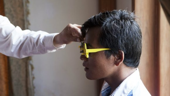 A man undergoes an eye examination in Cambodia.