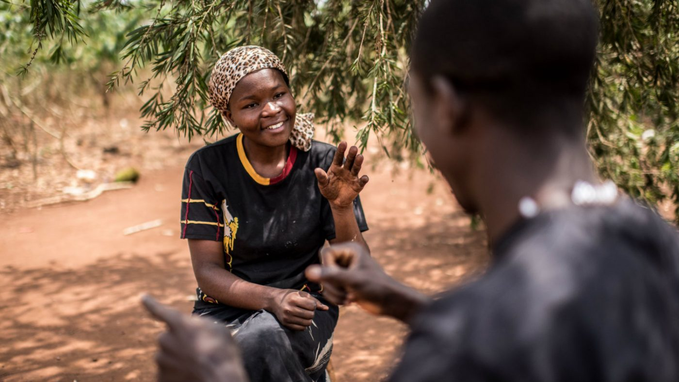 Grace using sign language to communicate.