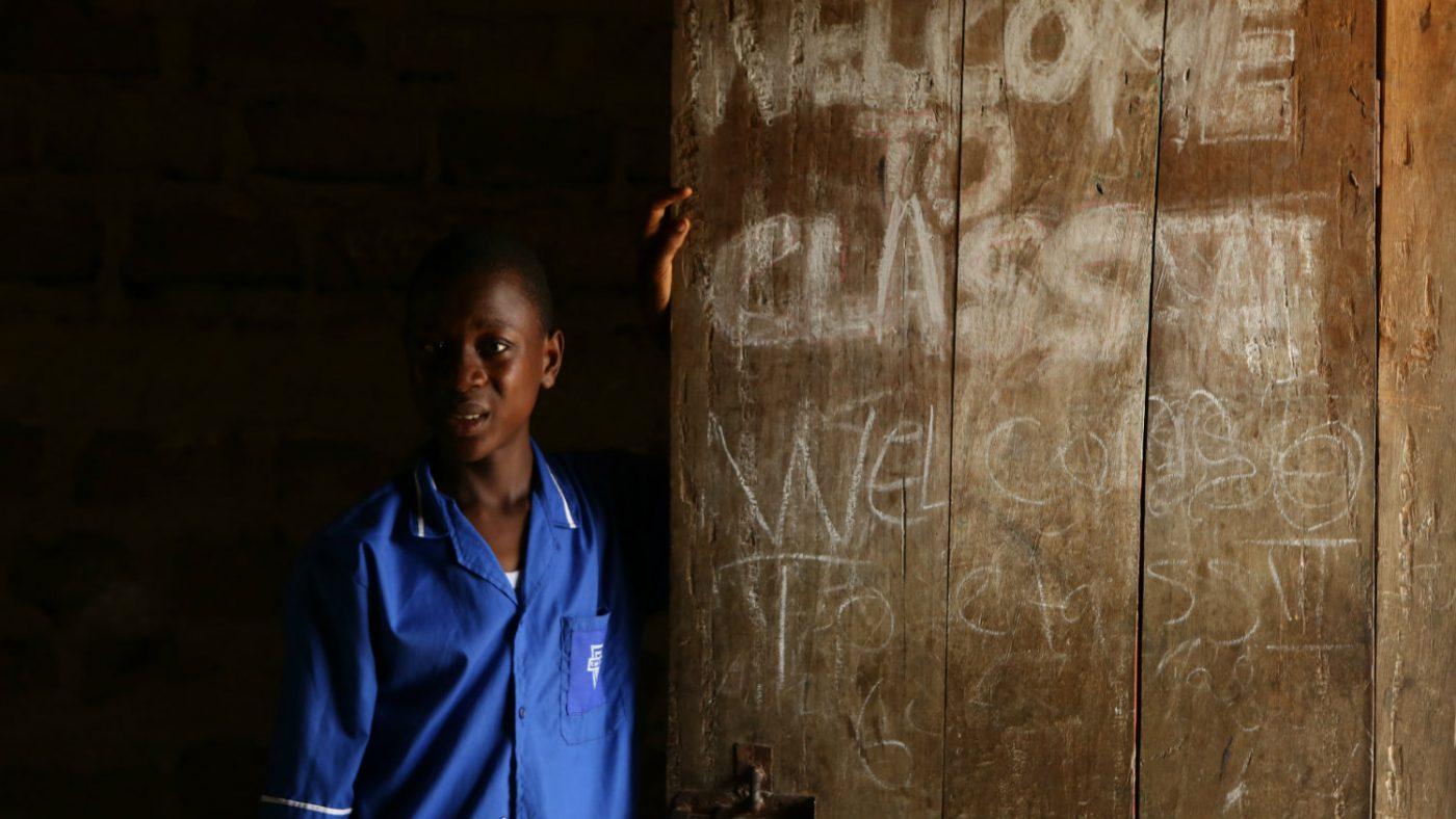 Henry stands by his classroom door.