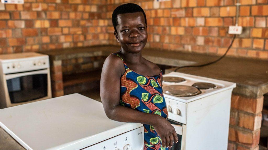 Hilda working in the kitchen