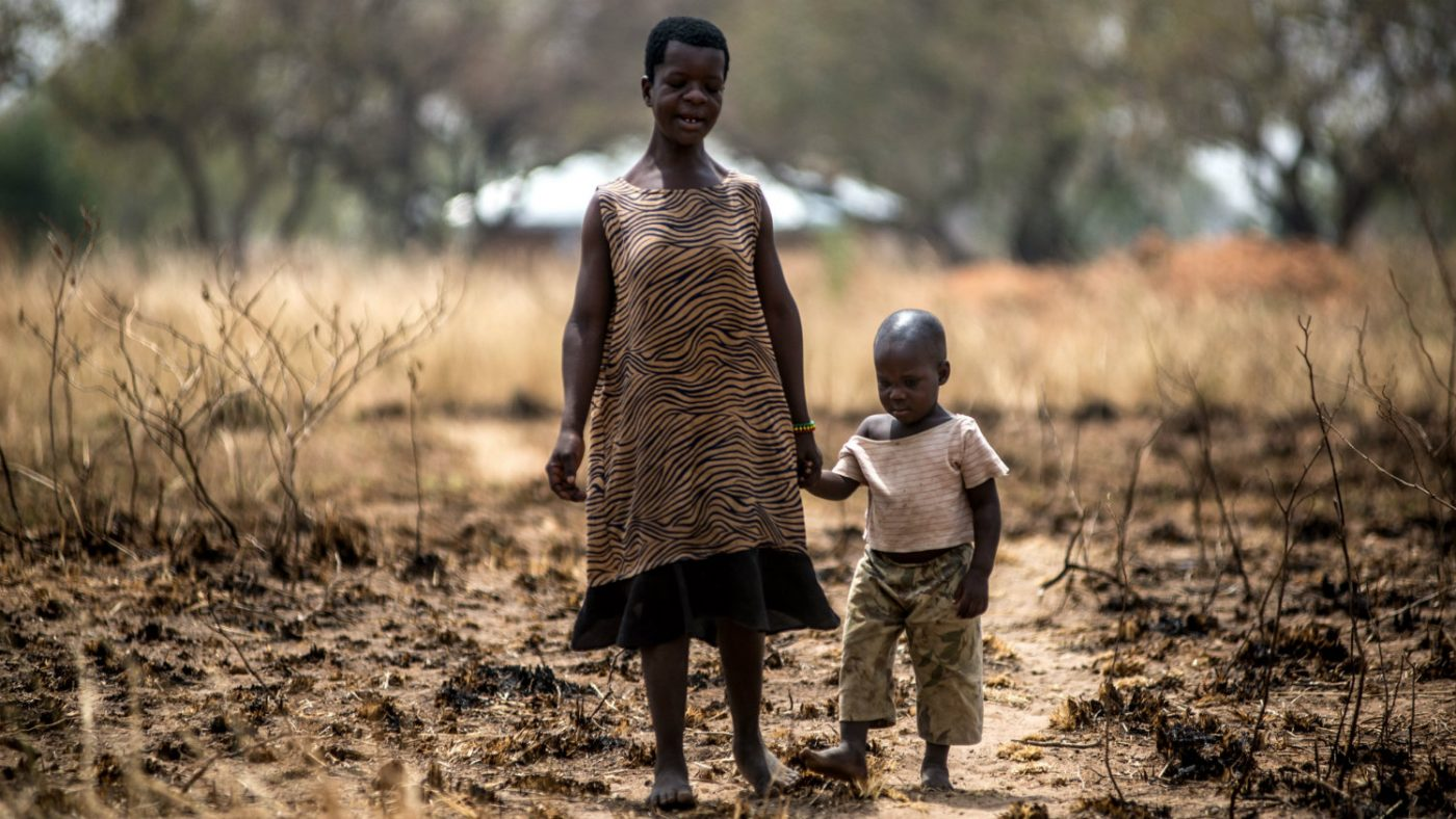 Hilda walking with her young son,