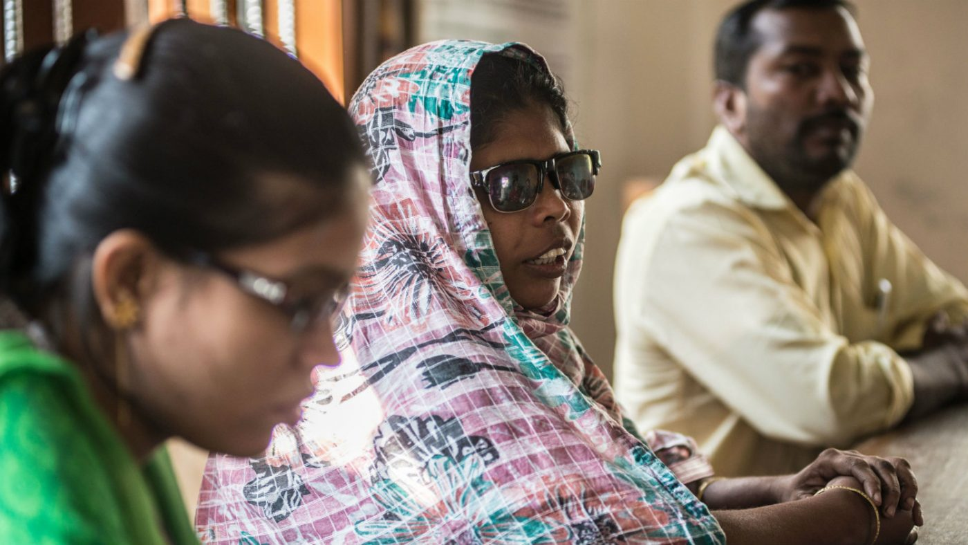 Jaharana attending a local government meeting.