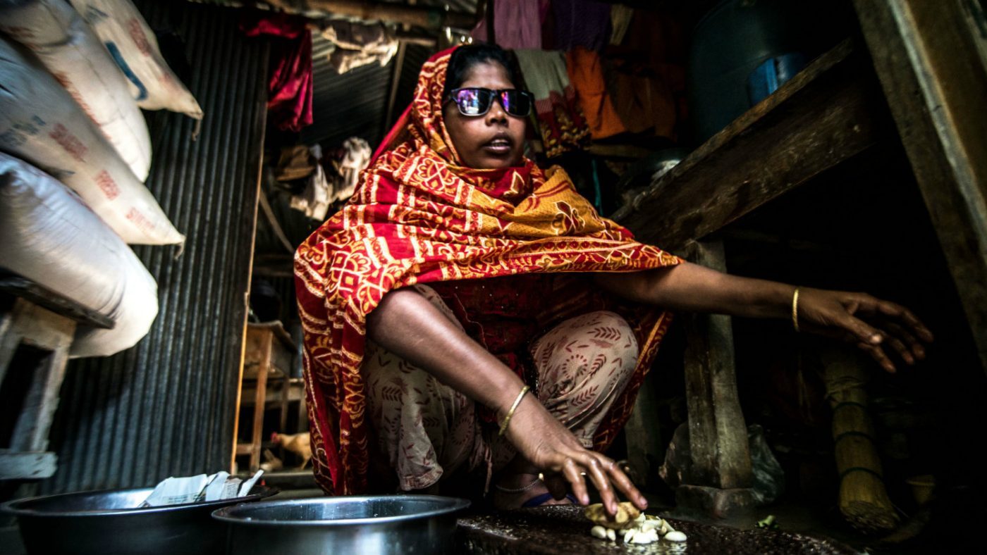 Jaharana preparing a meal at home.