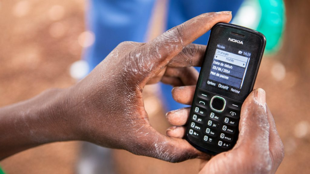 A mobile phone being used to collect data.