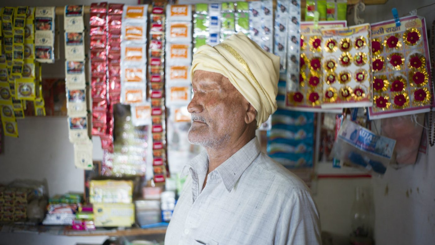 Sankarlal standing in his shop, which is also his home.