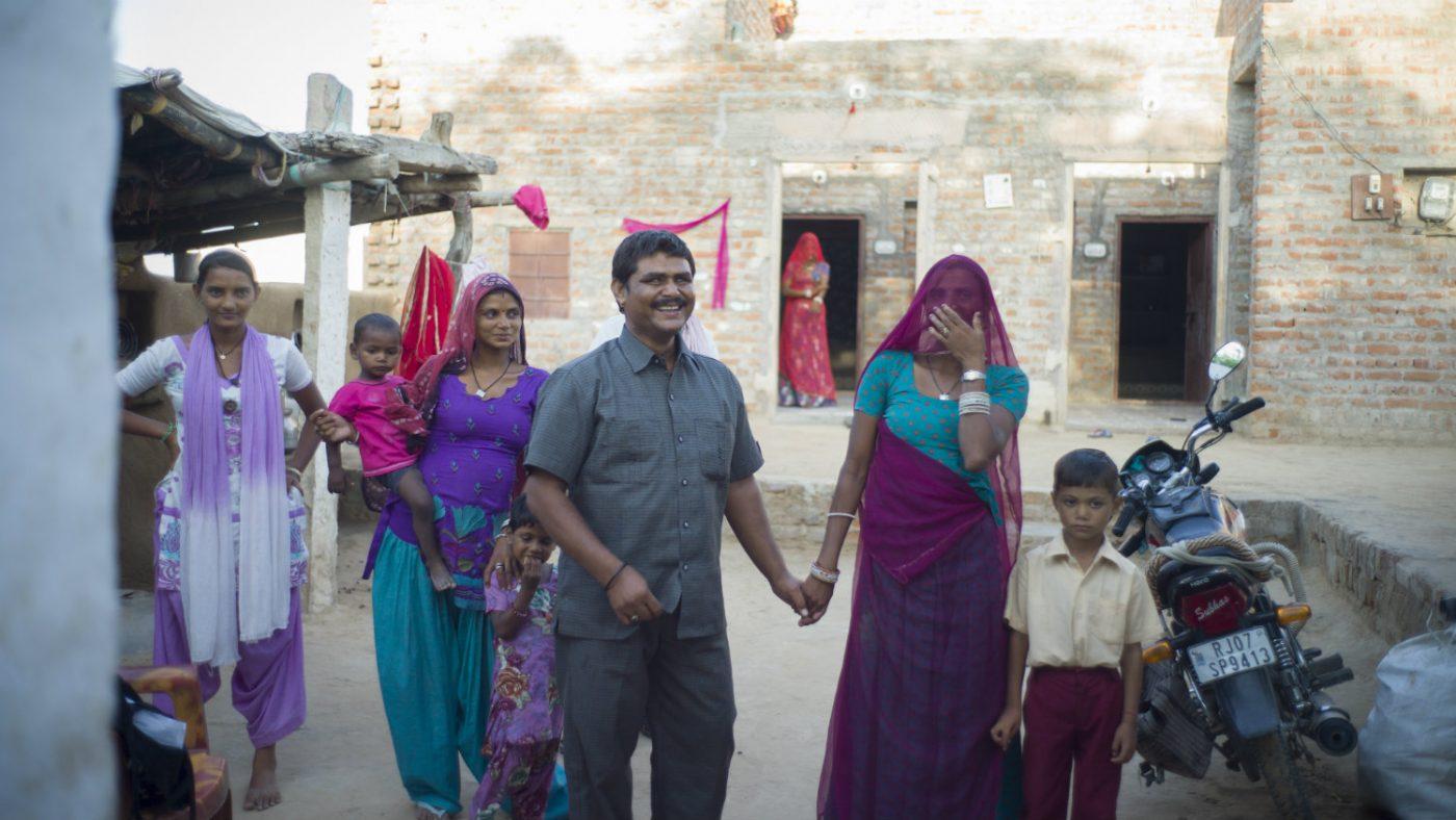 Sankarlal and his wife Gomati walking together.